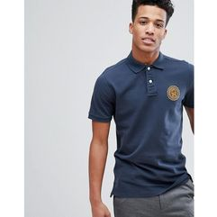heritage varsity badge logo slim fit polo in navy - navy marki Abercrombie & fitch